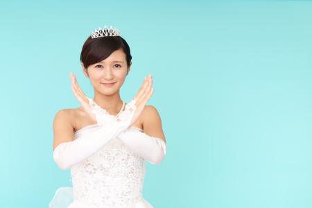 Beautiful bride demonstrating prohibiting gesture