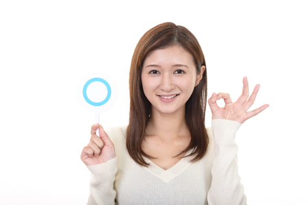 Woman with a Yes sign 版權商用圖片