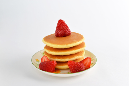 Fluffy and delicious pancakes on the plate