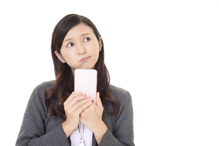 Woman holding a smart phone Stock Photo