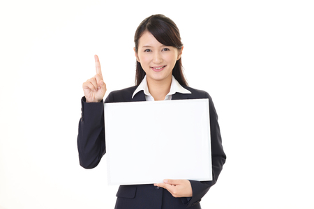 Smiling business woman with a whiteboard