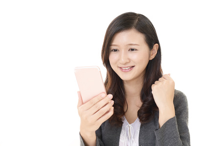 Woman looking at smart phone