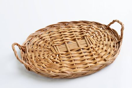 Brown wicker basket isolated over white