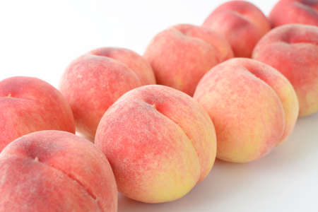 Delicious and fresh peaches on white background.