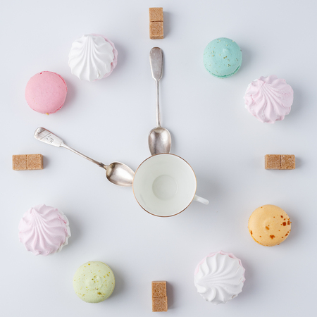 A clock in the form of coffee. macarons, sugar, marshmallows. creative and creative work. time to drink coffee
