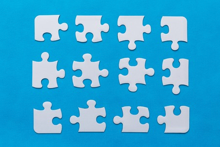 abstract puzzle background with piece missing. blue background