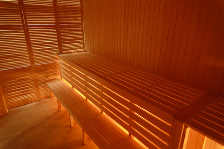 Interior of small home wooden sauna. Wooden benches