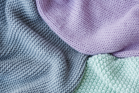 Gray, mint and lilac knitting wool texture background. Copy space