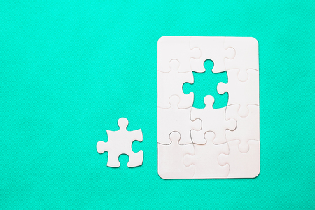 Jigsaw Puzzle with missing piece on mint background Top view