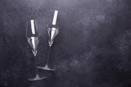 Champagne glasses on black stone background Copy space Top view