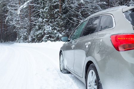 Gray car on winter road Snow forest