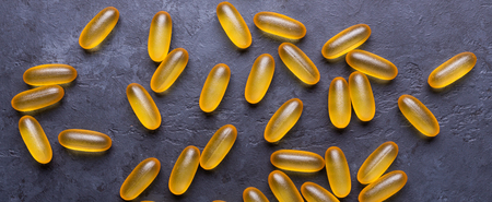 Capsules Omega 3 on dark stone background Close up Top view Health care concept Banner 写真素材 - 118583791