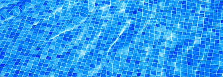 Blue ripped water in swimming pool Summer vacation Banner Top view Copy space