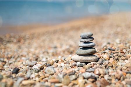 Balance of stones on the beach, sunny day. Sand on the beach