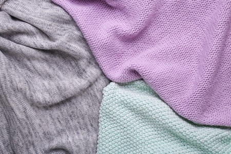 Gray, mint and lilac knitting wool texture background Crocheted fabric texture