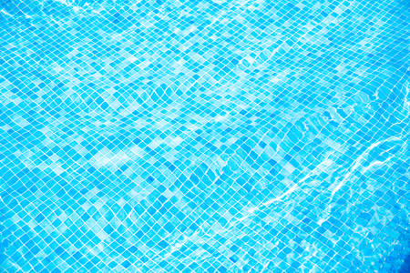 Blue ripped water in swimming pool Summer vacation Top view Copy space