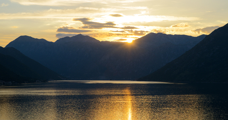 Beautiful sunset at bay of Kotor. Mountains and the sea 写真素材