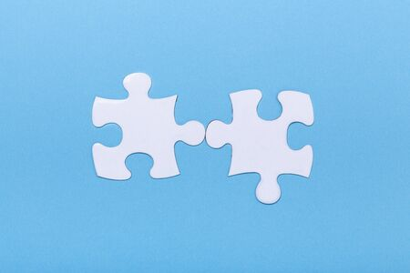 Closeup of jigsaw puzzle on blue background Missing jigsaw puzzle piece, business concept for completing the piece Teamwork concept