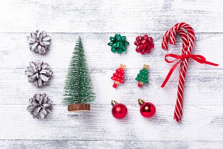 Christmas composition. Present box, gifts, fir tree, candy canes on wooden background. Flat lay, top view - Image