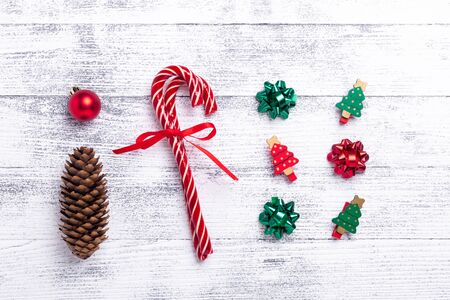 Christmas greeting card with gifts, fir tree and cone, candy canes on wooden background. Christmas, winter, new year concept. Flat lay, top view - Image Zdjęcie Seryjne