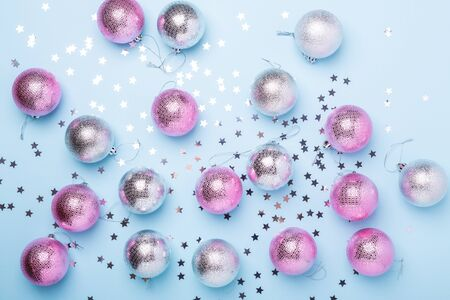 Christmas composition Pink, silver balls and sparkles on pastel blue background. Christmas, winter, new year concept. Flat lay, top view, copy space - Image