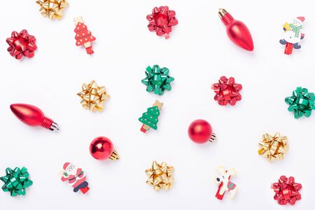 Christmas flat lay background. Red, green, gold gifts and bows on white background. Copy space. Christmas and New Year holiday concept - Image