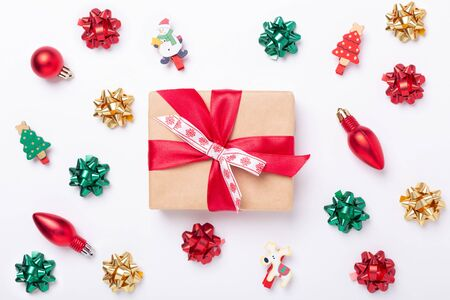 Christmas flat lay background with present box and decorations. Red, green, gold gifts and bows on white background. Christmas and New Year holiday concept - Image 写真素材