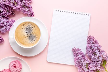 Lilac, cup of coffee, homemade marshmallow, notepad on pink background. Still life. Spring romantic mood. Top view. Copy space - Image 스톡 콘텐츠