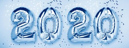 Silver balloons in the form of numbers 2020 and confetti. New year celebration. Classic Blue trendy color of the year 2020 - Image Stock fotó