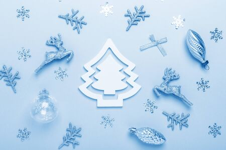 Christmas composition. Silver decoration on pastel blue background. Christmas, winter, new year concept. Color of the year 2020 classic blue toned - Image