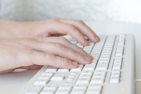 Man hands typing on computer keyboard, business man working on pc in office. Close-up - Image