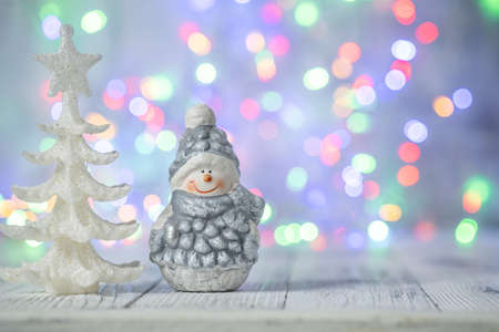 Christmas greeting card with decorative cute snowman. Bokeh effect on background - Image