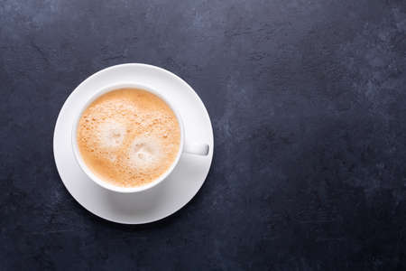 Cup of coffee on black stone background Top view Horizontal banner 版權商用圖片