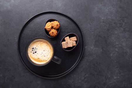 Cup of coffee, various sweets and spice on ceramic plate. Top view. Copy space - Image 版權商用圖片