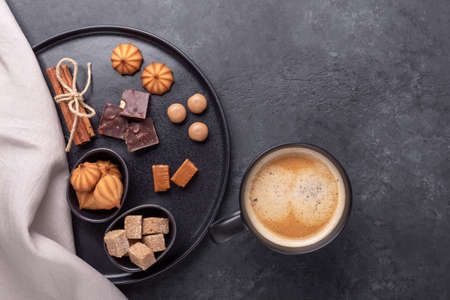 Coffee cup and Ceramic plate with various sweets and spiceon stone background. Top view. Copy space - Image 版權商用圖片