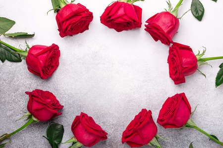 Frame of red rose flowers on stone background. Valentines day mockup - Image