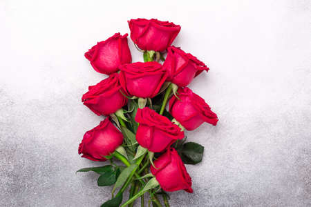 Valentines day greeting card. Bouquet of red roses on stone background - Image 版權商用圖片