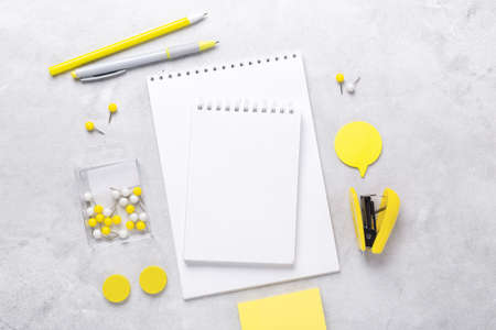 Top view of workspace with notepad and stationery accessories on gray stone background. Illuminating Yellow and Ultimate Gray, colors of the year 2021 - Image 版權商用圖片