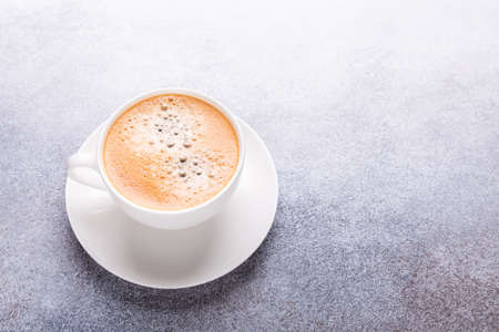 White cup of coffee on stone table. Top view - Image 版權商用圖片
