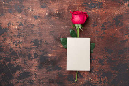 Valentine's day blank card with red rose flowers on vintage wooden background. Valentines day mockup - Image
