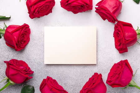 Valentine's day blank card with red rose flowers on stone background. Valentines day mockup - Image