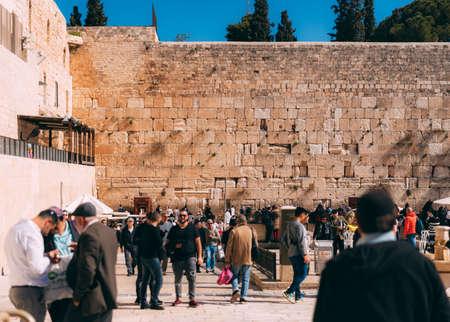 Jerusalem western wall with people. Cityscape image of Jerusalem. View of prayers, wishes and prays. Dome of the Rock in Jerusalem old city, Israel. Blue sky. Jerusalem day celebration Editorial