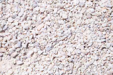 The texture of white stone minerals crumb. White abstract background. Gravel coating tracks. Top view. Reklamní fotografie