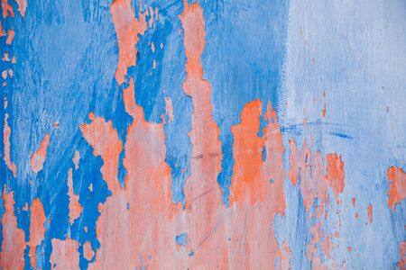 Abstract colorful wall texture and background. Close-up iron surface with old blue and pink paint