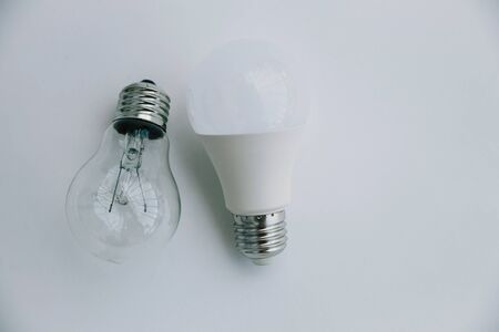 Incandescent lamp and LED lamp on a white background. Eco concept of saving electricity