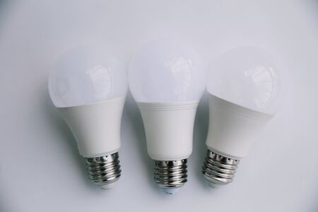 Three LED lamp on a white background. Eco concept of saving electricity