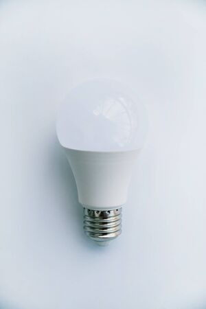 One LED lamp on a white background. Eco concept of saving electricity