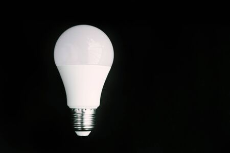 One LED lamp on a black background. Isolated. Eco concept of saving electricity
