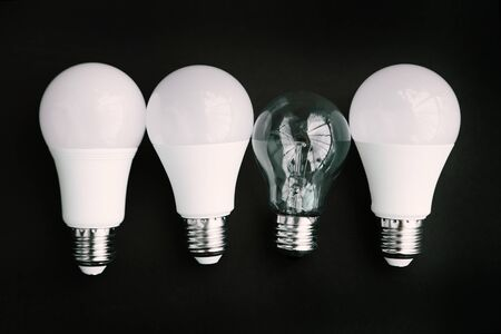 Incandescent lamp and LED lamps on a black background. Eco concept of saving electricity Zdjęcie Seryjne
