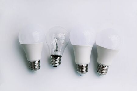 Incandescent lamp and LED lamps on a white background. Eco concept of saving electricity